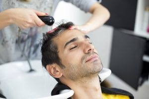 35501770 - young man at hairdresser