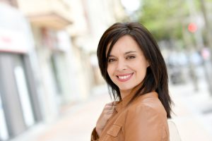 55595191 - smiling active woman walking in street